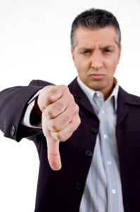 http://www.dreamstime.com/stock-photography-front-view-unhappy-boss-showing-thumb-down-image8871552